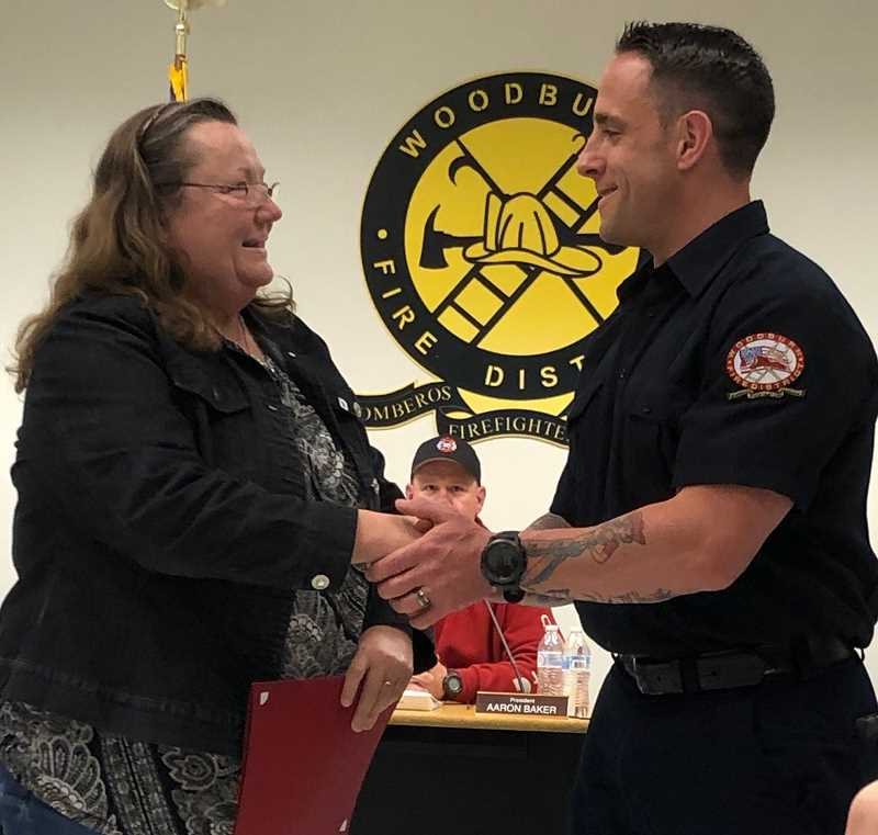 COURTESY OF WOODBURN FIRE DISTRICT - Woodburn Fire District  board member Deb Yager delivers the oath-of-office to new
