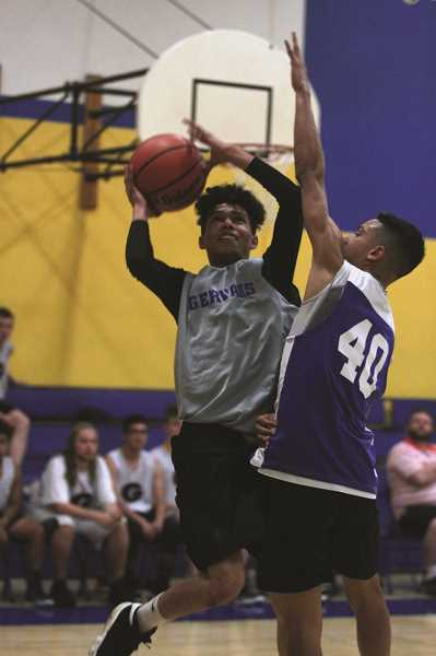 PMG PHOTO: PHIL HAWKINS - Incoming junior Kevius Gutierrez pulls up for a contested layup against Woodburn.