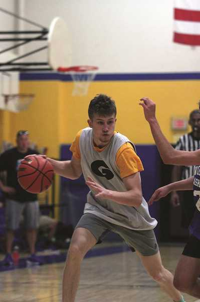 PMG PHOTO: PHIL HAWKINS - After transferring to Silverton for his junior year, 6-foot-4 post Alex Kalugin returns to Gervais for his senior season next year.