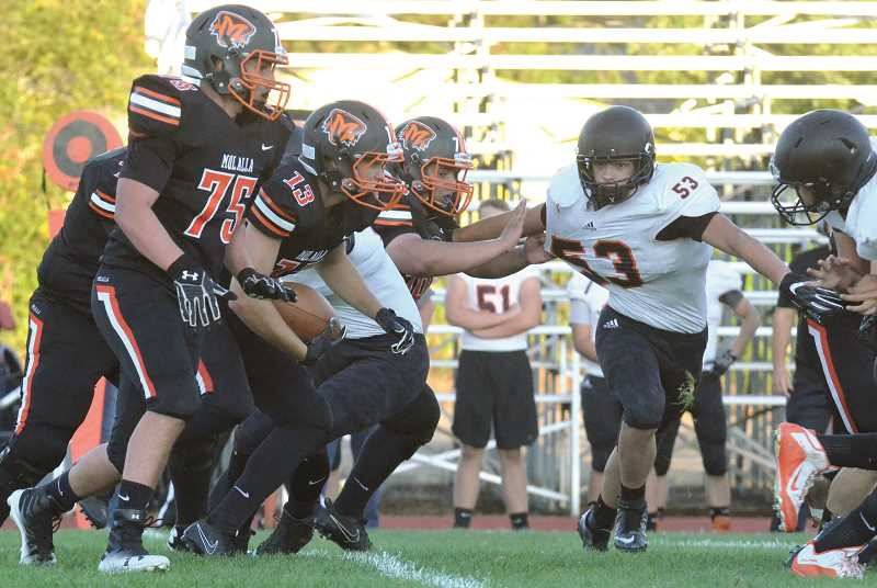 PMG FILE PHOTO: TANNER RUSS - Jeff Larsen runs the ball against non-league foe Scio. Molalla's season record was 2-7 at the end of the year this past year.