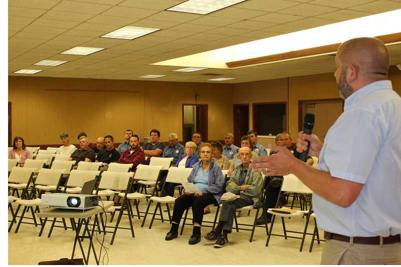 HOLLY M. GILL/MADRAS PIONEER - County Administrator Jeff Rasmussen, right, introduces the Matrix Consulting Group analyst, Robert Finn, at the fairgrounds meeting.