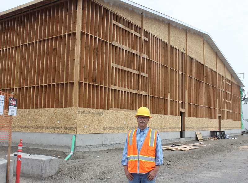 DESIREE BERGSTROM/MADRAS PIONEER - Dean Boyle, manager of the Madras Pratum Cooperative, stands in front of the 20,000-square-foot seed storage and cleaning facility going up at their Northwest Depot Road location. The new structure will be able to hold 3.5 million pounds of grass seed.