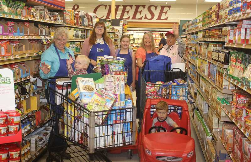 DESIREE BERGSTROM/MADRAS PIONEER - The Jefferson County Farm Bureau hosted a shopping trip for the Ronald McDonald House in Bend at Erickson's Thriftway in Madras. In the back, from left to right, are Janice Flegel, of the Crook-Wheeler County Farm Bureau, who is Oregon Farm Bureau's fourth vice president and Women's Advisory Council chairwoman, Kristie Glaser, of the Linn County Farm Bureau, who is the Women's Advisory Council's vice chairwoman, Kendra Glaser, Sue Vanek, president of Jefferson County Farm Bureau, and Mickey Killingsworth, secretary and treasurer of the Jefferson County Farm Bureau. In the carts, are, on the left, Gideon Flegel, and on the right, Jace Vanek.