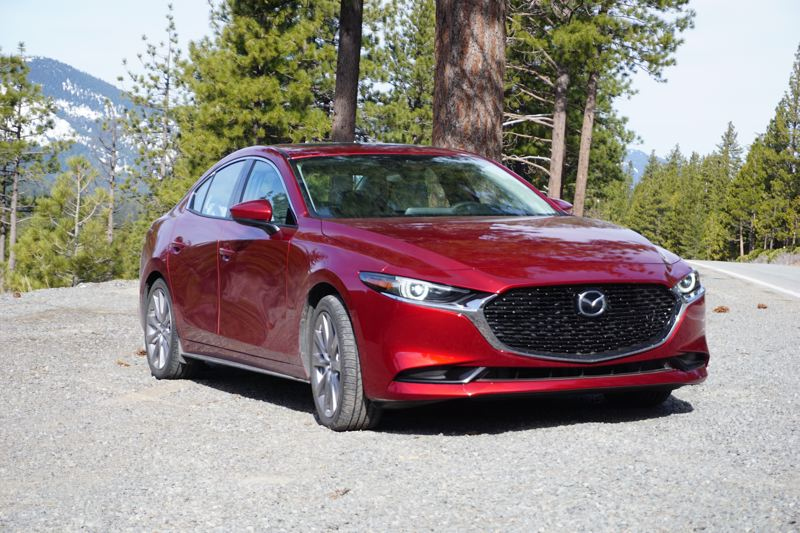 PMG PHOTO: JEFF ZURSCHMEIDE - The designed 2019 Mazda3 sedan is a stylish small car with a smooth and quiet ride, with all-wheel-drive available as an option for the first time.