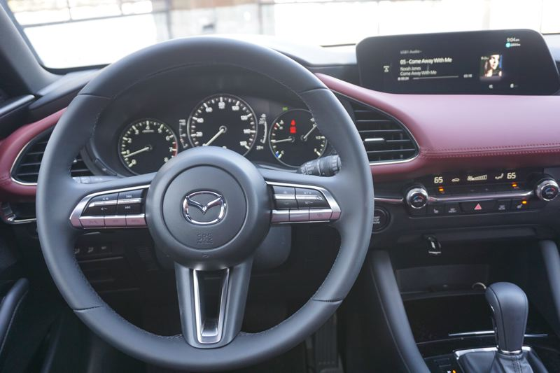 PGM PHOTO: JEFF ZURSCHMEIDE - The dash of the redesigned 2019 Mazda3 has a minimalist look with a much better integrated 8-inch display screen.
