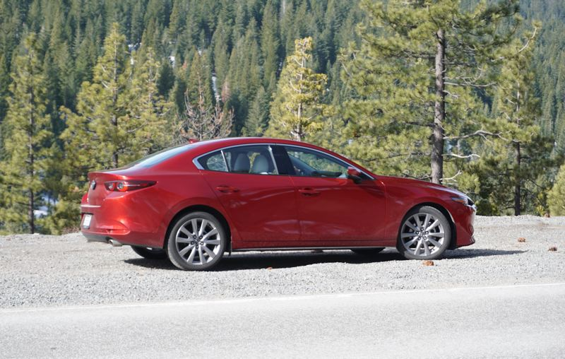 PMG PHOTO: JEFF ZURSCHMEIDE - The 2019 Mazda3 is attractive from any angle and strongly resmembles the newest version of the larger Mazda6.