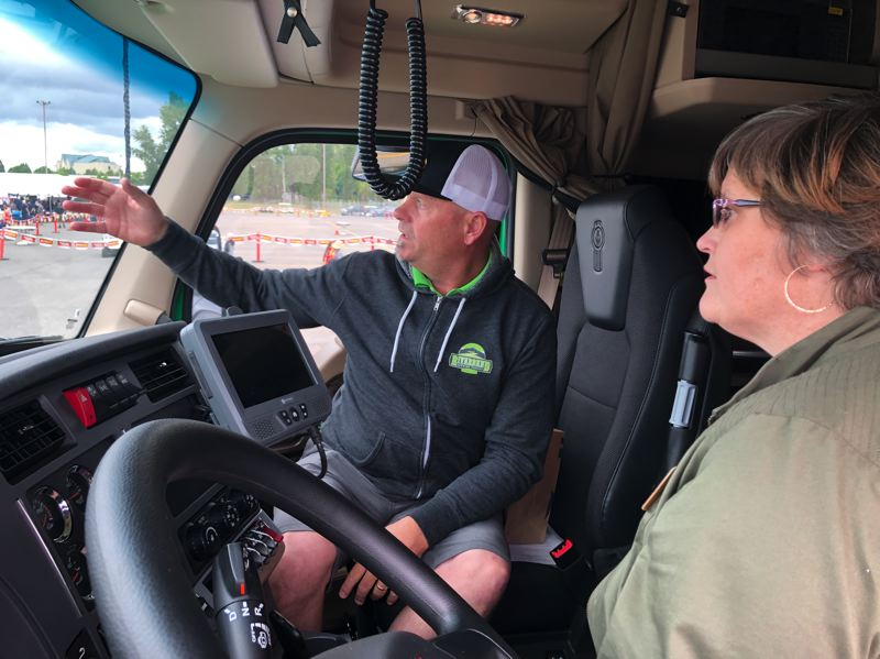 PMG PHOTO: STEPHANIE BASALYGA - David Hopkins, left, a logistics manager with TP Products, talks about the state of the trucking industry with Oregon Rep. Janeen Sollman, D-Hillsboro.