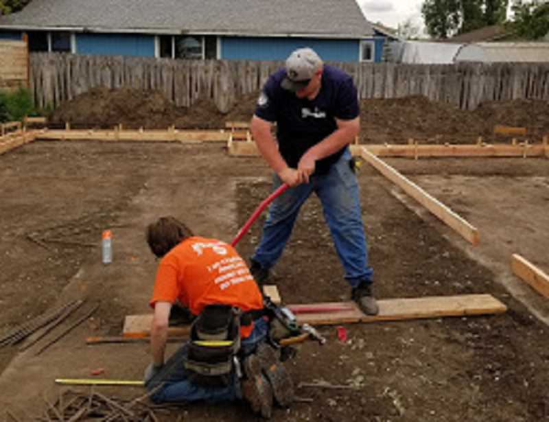 PHOTO COURTESY OF HEART OF OREGON CORPS YOUTHBUILD - A Heart of Oregon Corps YouthBuild crew works on the foundation of the Prineville house.
