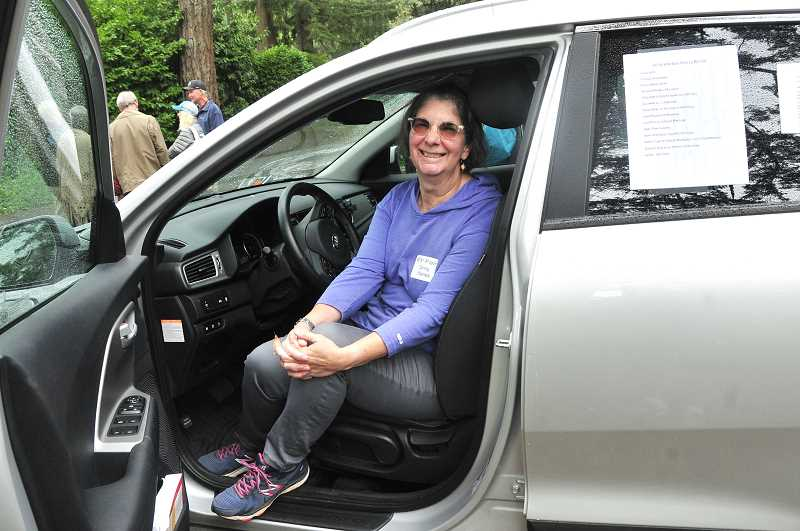 REVIEW PHOTO: VERN UYETAKE - Ginny Haines of Lake Oswegoproudly sits in the driver's seat of her Kia Niro plug-in hybrid.