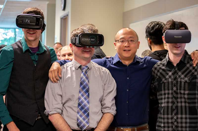 PMG PHOTO: CLARA HOWELL  - From left to right: Cobe Greene, Brian Locke, Yang Wang and Riggs Burnham show off their virtual reality project.