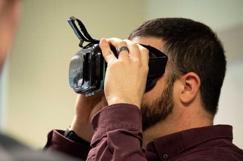 PMG PHOTO: CLARA HOWELL  - Brandon Walter tries out the virtual reality headset.