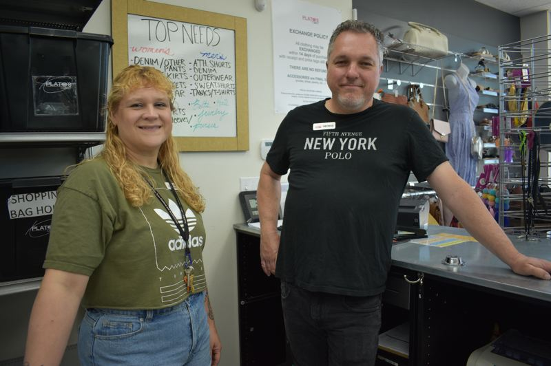 PMG PHOTO: SHANNON O. WELLS - Joanna Beall and George Merkl pride themselves on their efficient, fair approach to sorting and pricing used clothing and accessories customers bring in to sell at Platos Closet.