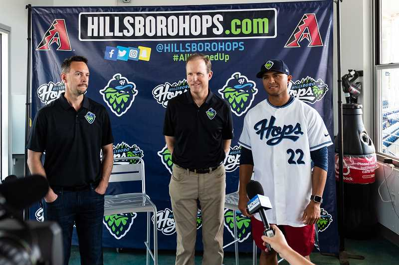PMG PHOTO: CHRISTOPHER OERTELL - Hillsboro Hops President and General Manager K.L. Wombacher, broadcastor Rich Burk, and new manager Javier Colina take questions during Media Day Wednesday, June 12, at Ron Tonkin Field in Hillsboro.