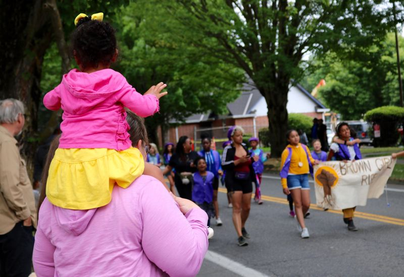 PMG PHOTO: ZANE SPARLING - Residents watch as members of Brown Grirls Rise march past during a Juneteenth celebration in Portland on Saturday, June 15.