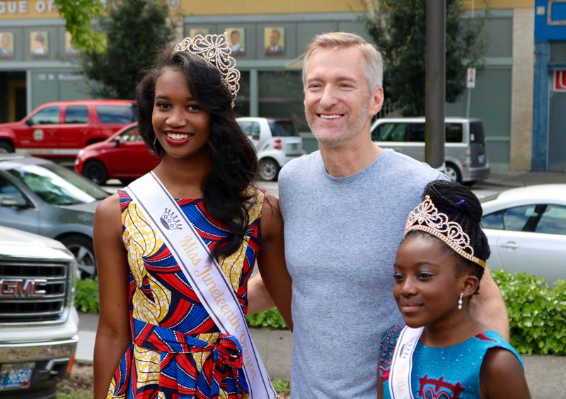 PMG PHOTO: ZANE SPARLING - Mayor Ted Wheeler poses for a photo with Miss Juneteenth, Aceia Spade, and Little Miss Juneteenth Victorina Tchivandja.
