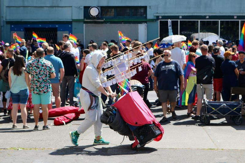 PMG PHOTO: ZANE SPARLING - A vendor trots along during the 2019 Portland Pride Parade on Sunday, June 16.