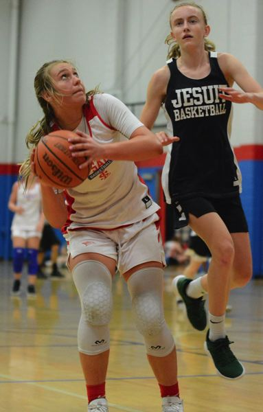 PMG PHOTO: DAVID BALL - La Salle Preps Addi Wedin makes a move to the basket after receiving a pass on the block.