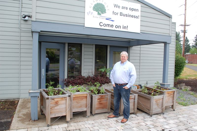 PMG PHOTO: RAYMOND RENDLEMAN - Colin Black, Gladstone Senior Center manager, is proud of the recent installation of six 3-foot square cedar planter beds on a new patio.