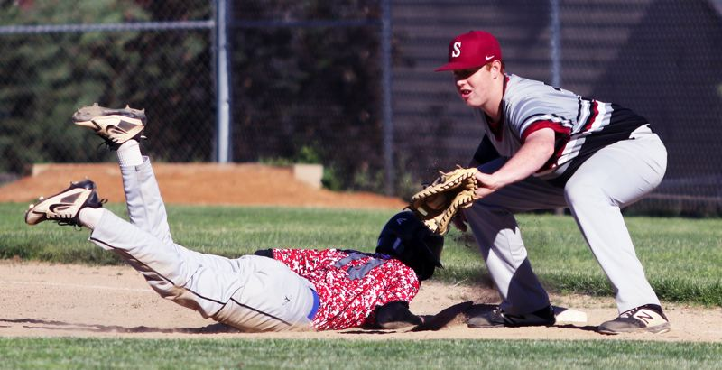 PMG PHOTO: DAN BROOD - Sherwood High School junior-to-be first baseman Eli Holbert (right) started a sixth-inning triple play that helped the Bowmen come away with a 7-1 win over La Salle.