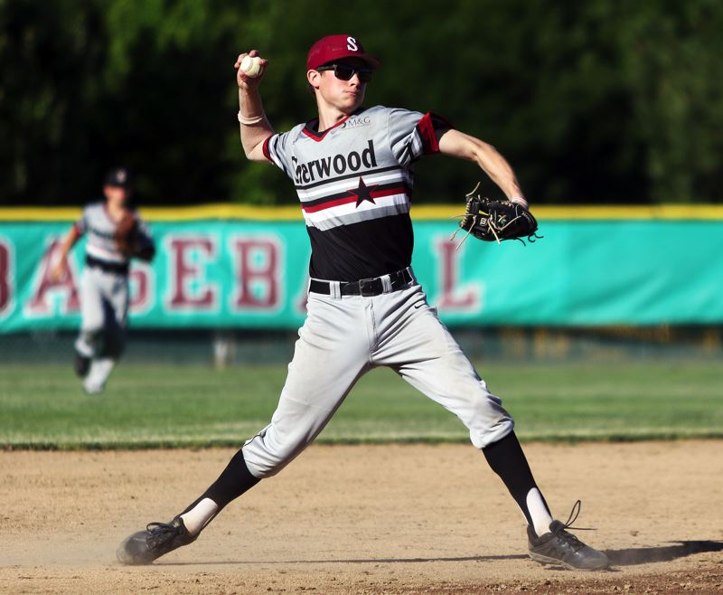 PMG PHOTO: DAN BROOD - Sherwood High School senior-to-be Kaedin Steindorf gets ready to make a throw to first base during the Bowmen's 7-1 win over La Salle on Friday.