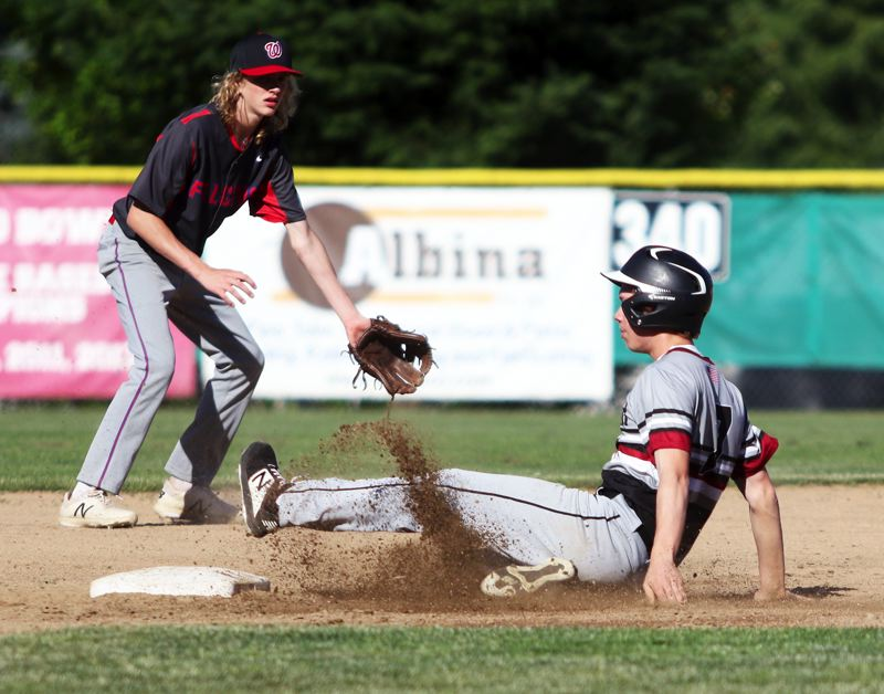 PMG PHOTO: DAN BROOD - Sherwood's Jay Baldwin (right) slides safely to second base on a stolen-base attempt during the Bowmen's 7-1 OIBA win over La Salle on Friday.