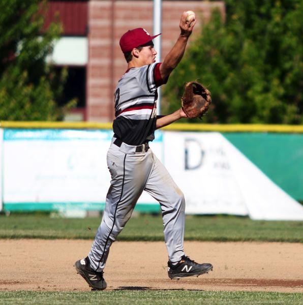 PMG PHOTO: DAN BROOD - Sherwood second baseman Chase Highberger makes a throw to first base during the Bowmen's 7-1 OIBA win over La Salle on Friday.