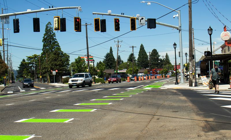 PBOT PHOTO  - New traffic signals, decorative street pole lighting and a green-striped bike lane are shown here at the corner of Southeast Foster Road and Holgate Boulevard.
