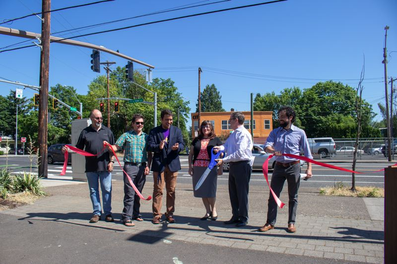 PBOT PHOTO - Local dignitaries, including Commissioner Chloe Eudaly and PBOT director Chris Warner, cut the ribbon on the new Foster Road Streetscape improvements.