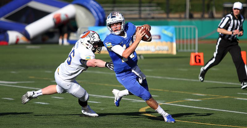 PMG PHOTO: MILES VANCE - Lake Oswego quarterback Jackson Laurent scambles for time during his North team's 33-28 loss to the South in the Les Schwab Bowl at Hillsboro Stadium on Saturday, June 15.