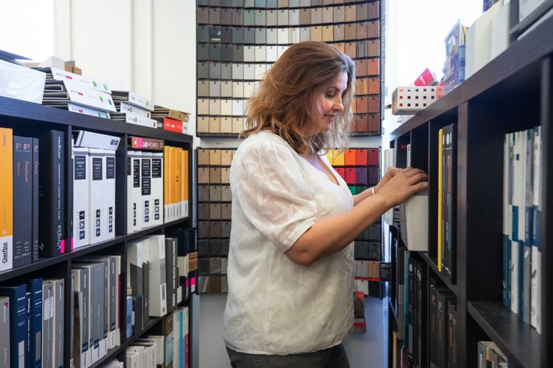 TRIBUNE PHOTO: JONATHAN HOUSE - Nicole Schmidt, an interior designer turned sales rep, was working gor a counter-top manufacturer when she came up with idea for Krowdsourced, a materials library that combines an online platform with an office filled with physical samples.