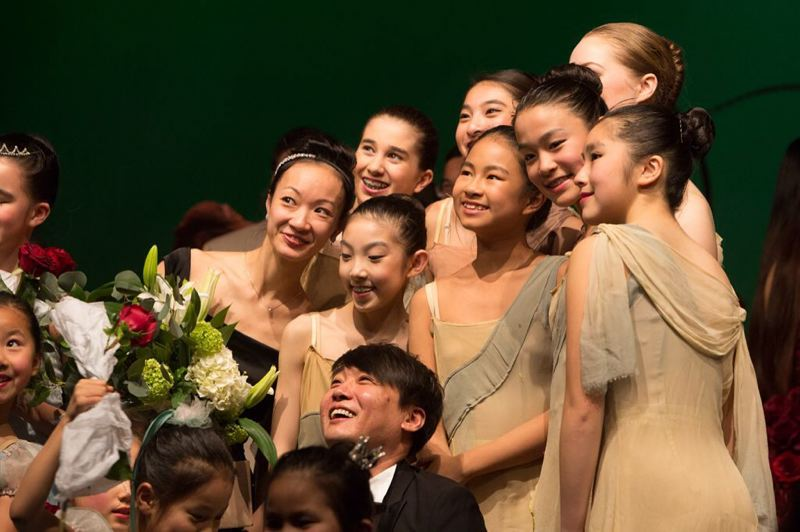 COURTESY PHOTO - Xuan Cheng and Ye Li celebrate among some dancers. Says Cheng: 'We had all this experience, why not pass it on to the next generation?'