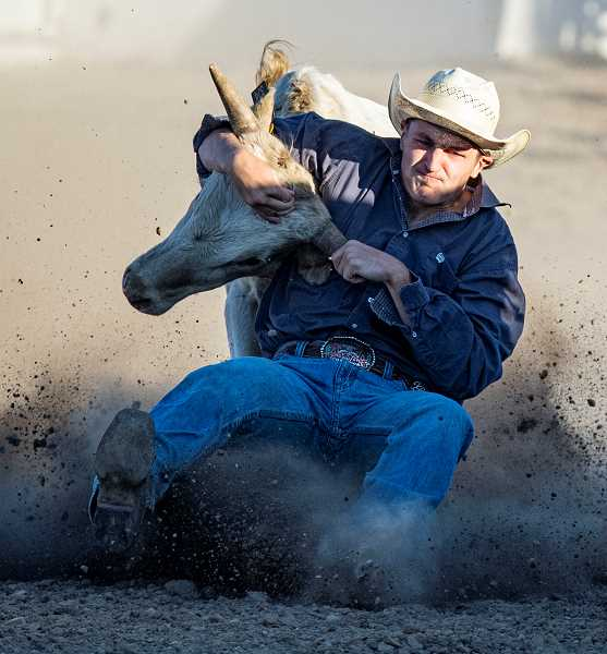 LON AUSTIN/CENTRAL OREGONIAN - Jaxson Rhoden makes a successful steer wrestling run. Rhoden finished sixth in the final standings in the event.