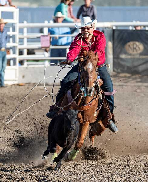 LON AUSTIN/CENTRAL OREGONIAN - Bubba Luttrell makes a tie-down roping run. Luttrell did not place in either of his two runs in the event.