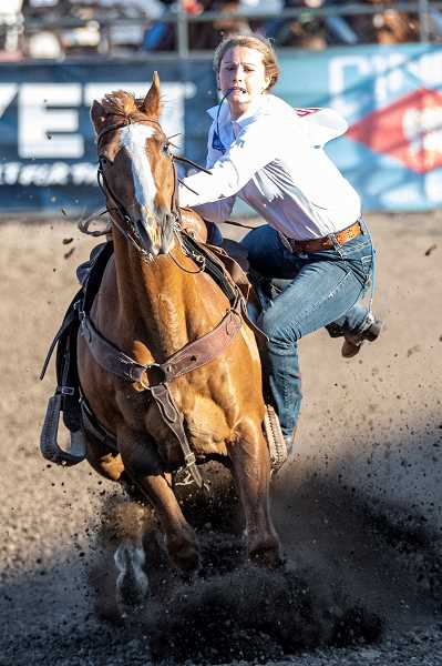 LON AUSTIN/CENTRAL OREGONIAN - Paige Pentzer makes a goat tying run on Thursday during the second go round at the Oregon High School Rodeo Association State Finals. Pentzer did not place in the round.