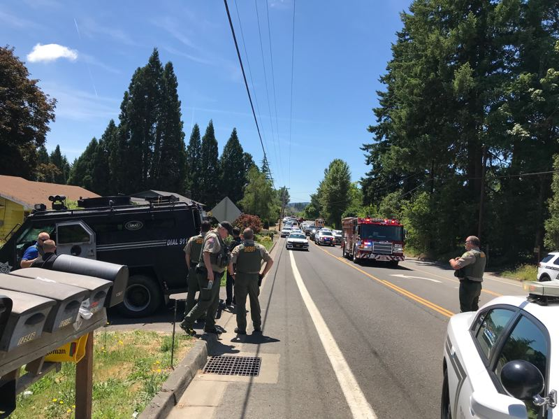 CCSO PHOTO - A Clackamas County SWAT team responded to Happy Valley on Monday, June 17, after a man reportedly stabbed himself and another woman.