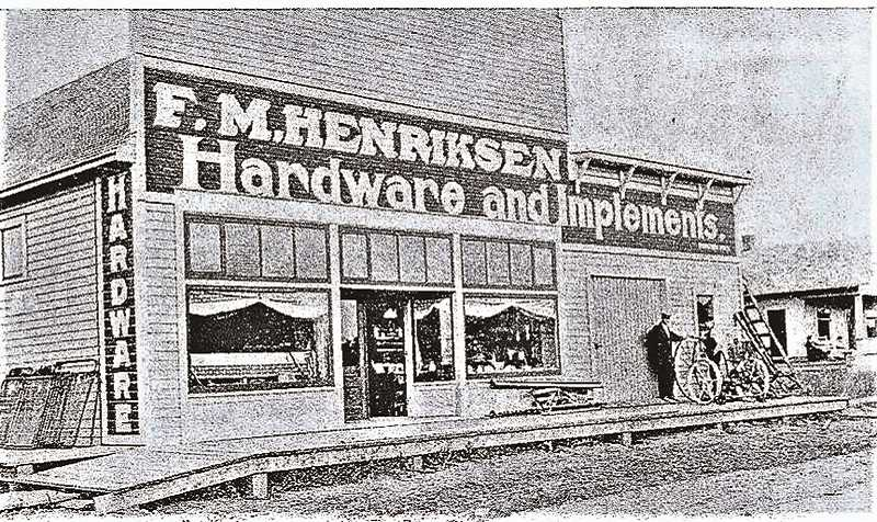 COURTESY PHOTO: ENTERPRISE COURIER, 1914 ANNIVERSARY EDITION - :  F. M. Henricksen Hardware and Implements was located on the southeast corner of South Molalla Avenue and East Second Street, where Lam's Chinese Kitchen is located today.  Fred had a very successful store due to his large stock of goods.