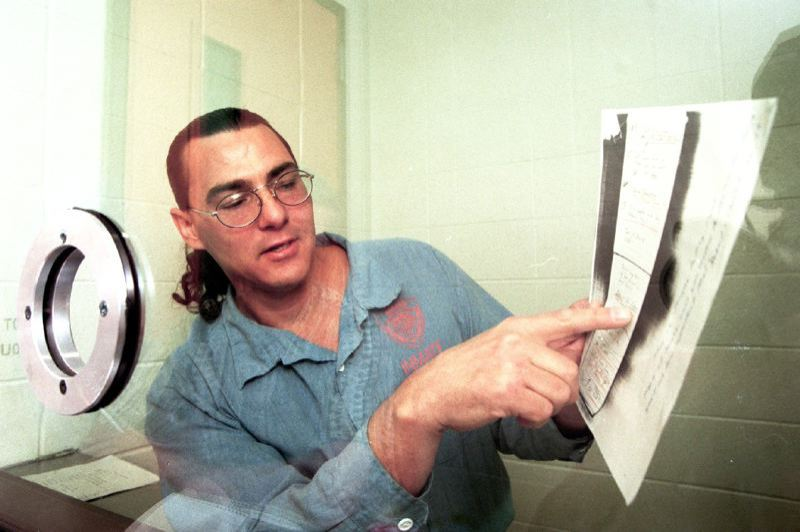 COURTESY SALEM STTESMAN-JOURNAL - Frank Gable in prison with court records in an undated photograph.