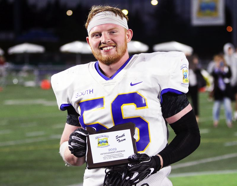 PMG PHOTO: DAN BROOD - Sherwood's Carter Atkins, who had a huge game at defensive end, was named the Lineman of the Game for the winning South team in Saturday's Les Schwab Bowl.