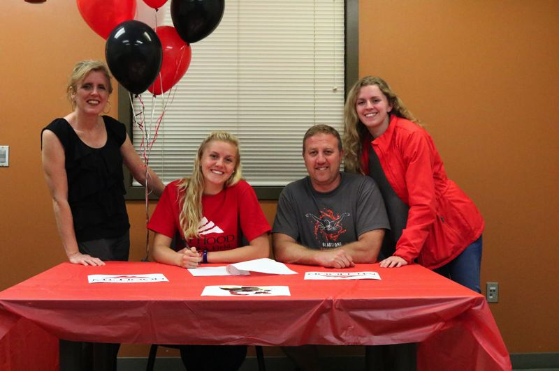 Gladstone High Schools Avery Marshall confirmed her commitment to Mt. Hood Community College alongside her mother Alicia, father Tim, and sister Ariel during a June 5 signing ceremony in the main office.