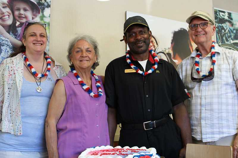 PMG PHOTO: AVA EUCKER - From left, Sandy Seebers, Connie Connor, Deon Robertson and fellow community member celebrate Robertsons final week at McDonalds.
