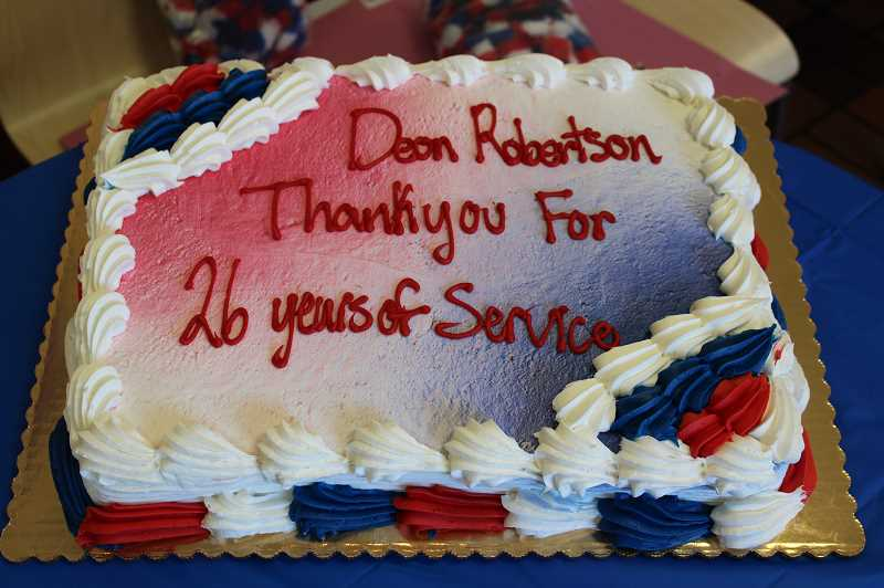 PMG PHOTO: AVA EUCKER - Store Manager Shelly Nelson ordered a cake for customers and staff to enjoy while honoring Robertson.