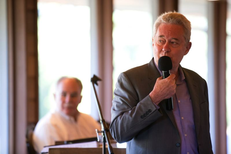 PMG PHOTO: JAIME VALDEZ - Tim Nesbit, right, and Allen Alley discuss the PERS crisis at the Tualatin Chamber of Commerce.