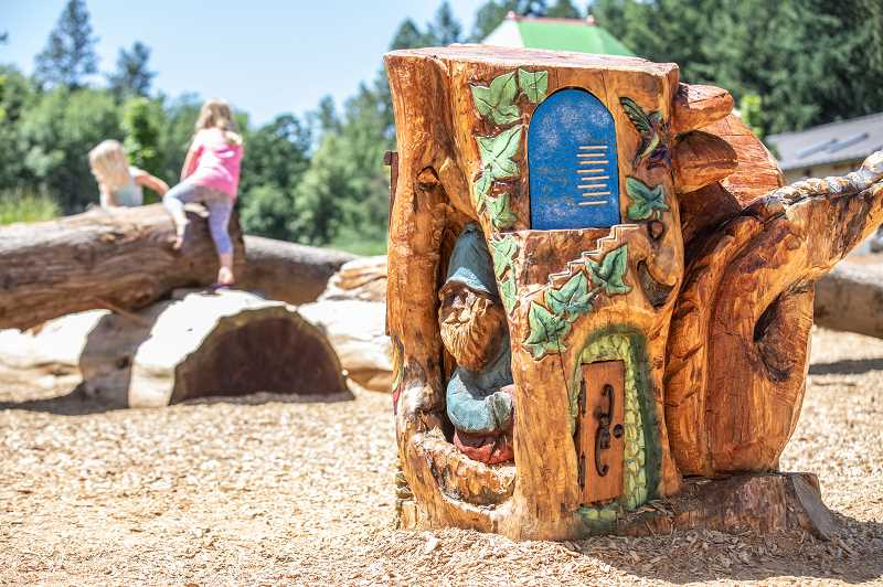PMG PHOTO: JONATHAN HOUSE - Almost 30 fairy doors adorn wooden chainsaw art sculptures in Dirksen Nature Park in honor of the late Paul Izatt, Tigard Parks and Rec employee who died unexpectedly in January 2018.