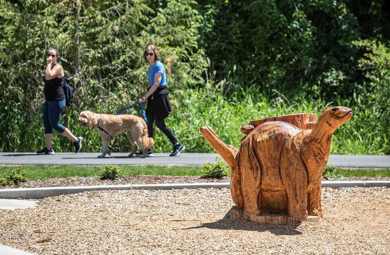 PMG PHOTO: JONATHAN HOUSE - Chainsaw artist James Lukinitch paid great attention to detail in creating numerous sculptures in Dirksen Nature Park.