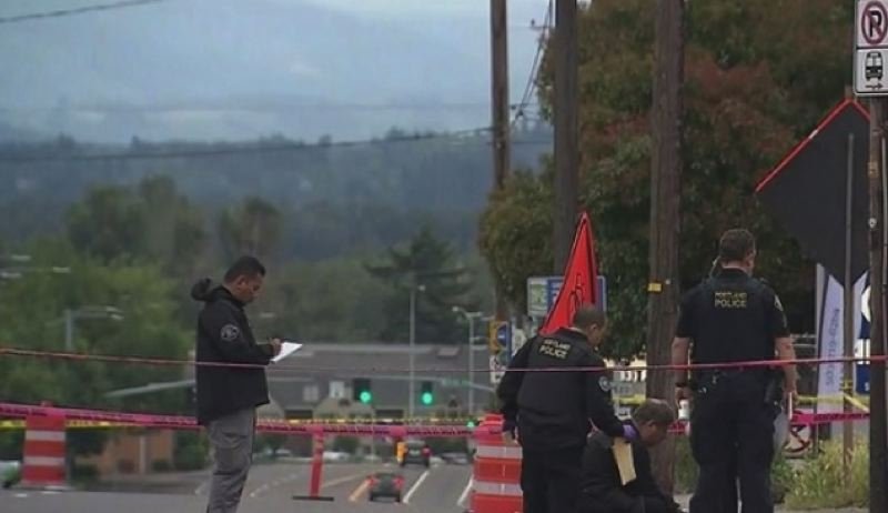VIA KOIN 6 NEWS - Portland Police Bureau investigators respond to the scene of a fatal shooting on Northeast Sandy Boulevard on Wednesday, June 19.