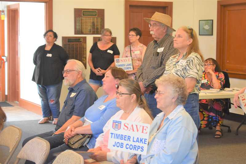 PMG PHOTO: EMILY LINDSTRAND - Some attendees of a town hall meeting for Timber Lake Job Corps earlier this week held signs in support of the organization.