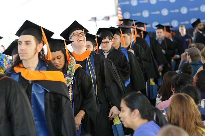 COURTESY PHOTO  - Francis Bartholomew gets ready to receive his diploma with other Class of 2019 graduates.