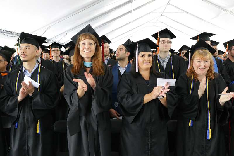COURTESY PHOTO  - Faculty cheer for students during Oregon Tech's graduation June 16 in Wilsonville.