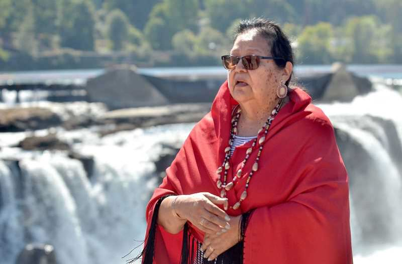 PMG FILE PHOTO: VERN UYETAKE - Cheryle Kennedy speaks of tribal heritage and the salmon in front of Willamette Falls last year.