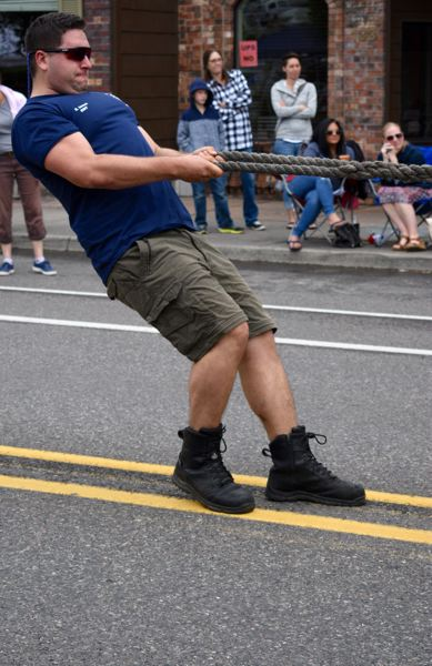 PMG FILE PHOTO: MATT DEBOW - Sam Ionesi pulls as anchor during the lasts year Muscle Hustle in the Corbett Fire Department teams first attempt.